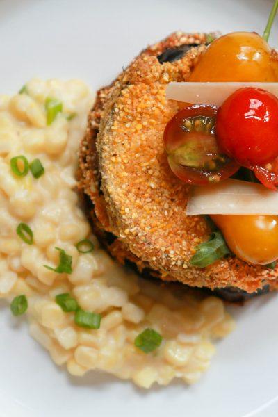 cornmeal crusted eggplant with parmesan creamed corn and heirloom tomato salad